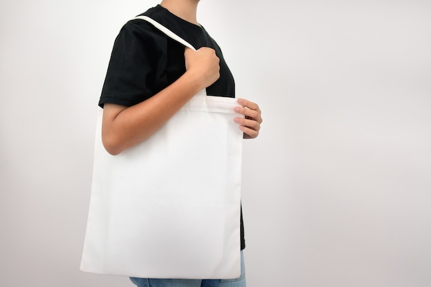 Hipter woman holding eco fabric bag