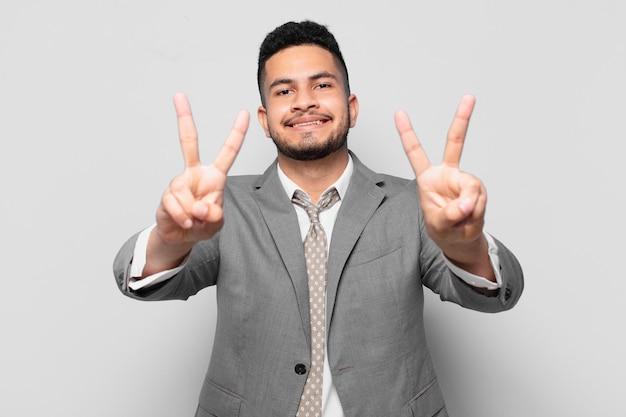 Hispanic businessman celebrating successful a victory