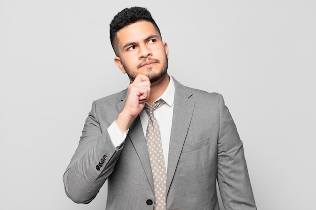 Hispanic businessman doubting or uncertain expression