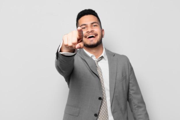 Hispanic businessman pointing or showing