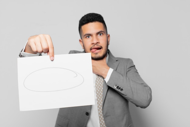 Hispanic businessman scared expression and holding a sheet of paper