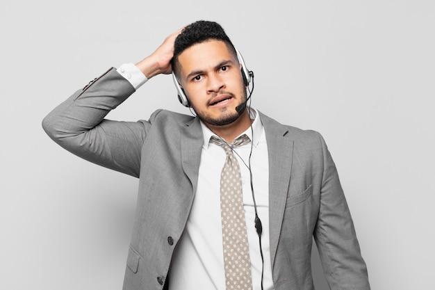Hispanic businessman scared expression telemarketer concept
