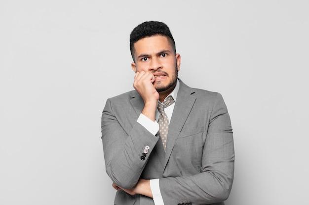 Hispanic businessman scared expression