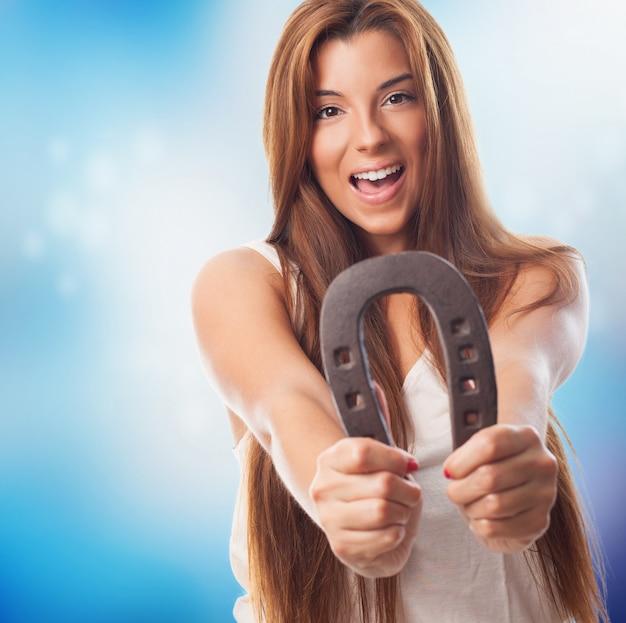 Hispanic girl with horseshoe