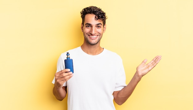 Hispanic handsome man feeling happy, surprised realizing a solution or idea. vaporizer concept