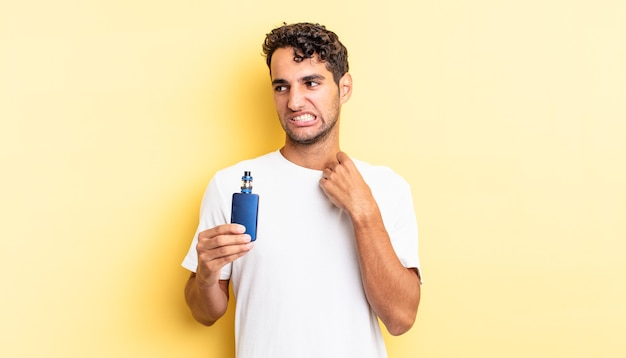 Hispanic handsome man feeling stressed, anxious, tired and frustrated. vaporizer concept