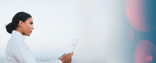 Hispanic woman using a digital tablet