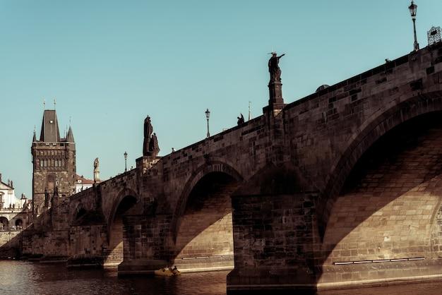 The historic 14th century charles bridge in prague over the river vlatava. prague, czech republic