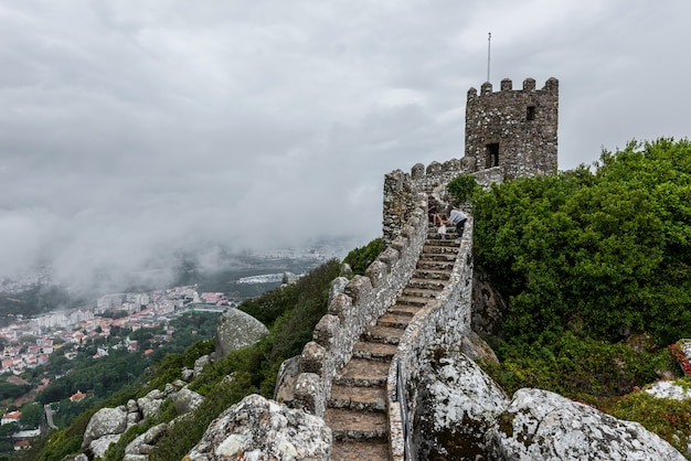 Historic castle of the moors in sintra, portugal on a foggy day