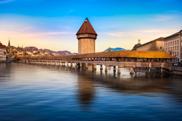 Historic city center with its famous chapel bridge and mt. pilatus on the background