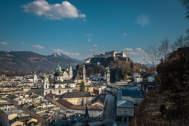 Historic city of salzburg with hohensalzburg fortress in beautiful evening light in fall in austria