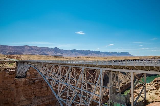Historic navajo steel bridges over colorado river spans marble grand canyon