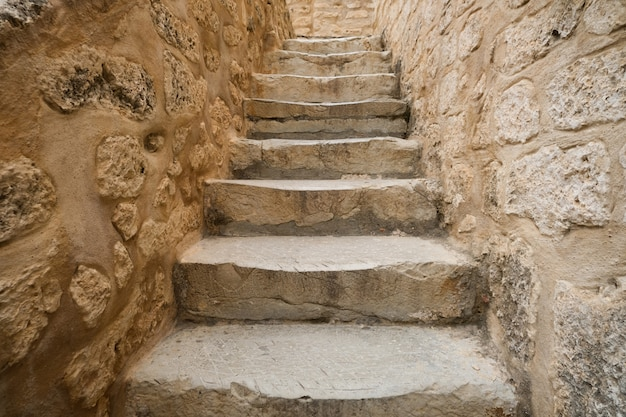 Historic old staircase in the fortress. vintage stairs of stone.