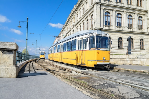 Historic yellow trams in central budapest