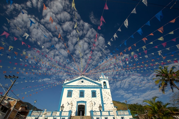 Historical church adorned with colorful flags