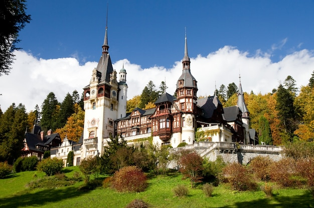 Historical sinaia monastery surrounded by green trees in sinaia, romania