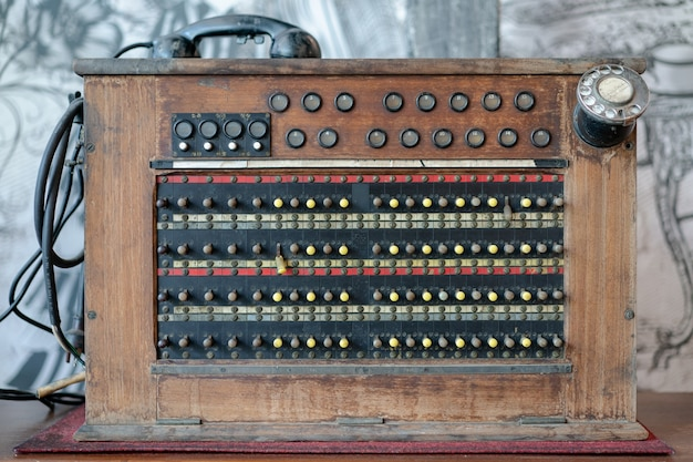 Historical, telecommunications system. old vintage telephone switchboard.