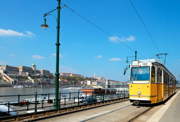 Historical tram runs on the riverside in budapest