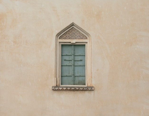 Historical vintage window on wall
