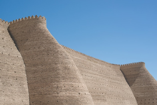 Historical walls of ark fortress in bukhara, central asia