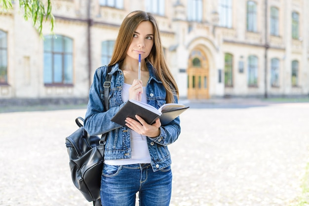 Hmm! intelligence people life style jeans concept. close up photo portrait of cute beautiful lovely clever smart girl holding pencil near lips mouth preparing new project presentation history lesson