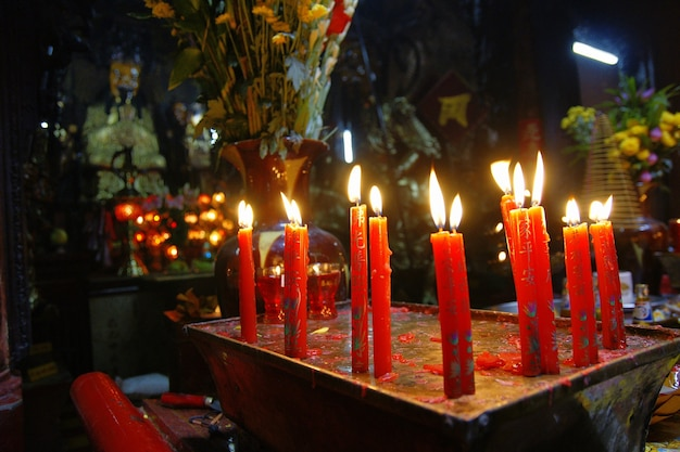 Ho chi ming, vietnam - 27 october 2011: asian religious people praying in vietnam temple