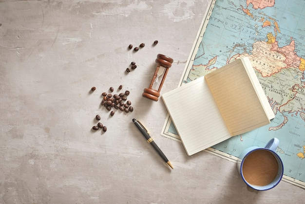 Ho chi minh city, vietnam - 22 september, 2018: go on an adventure! top view of planning traveling trip notes wanderlust. travel planning concept on map with traveler