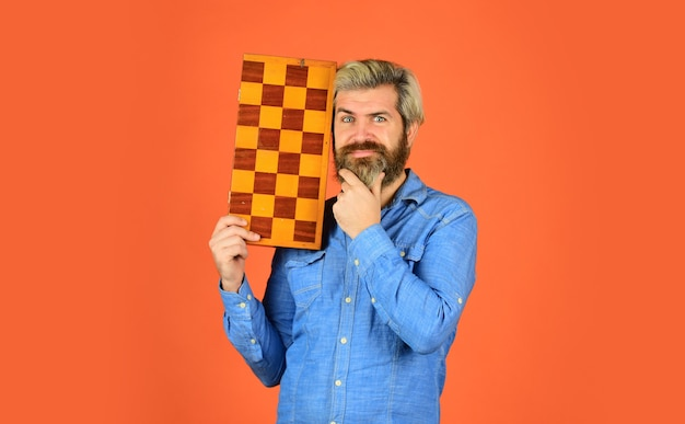 Hobby and leisure. intellectual games. chess lesson. teacher chess competition. chess figures. game strategy concept. board game. man playing chess. intelligent bearded hipster. cognitive skills.