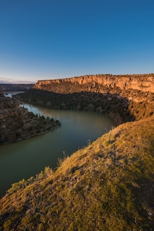 Hoces del duraton canyon natural park during golden hour in segovia, spain.