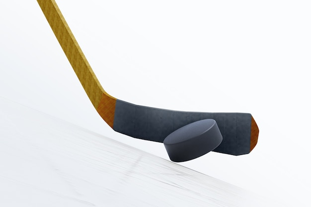 Hockey stick and floating puck on the ice rink