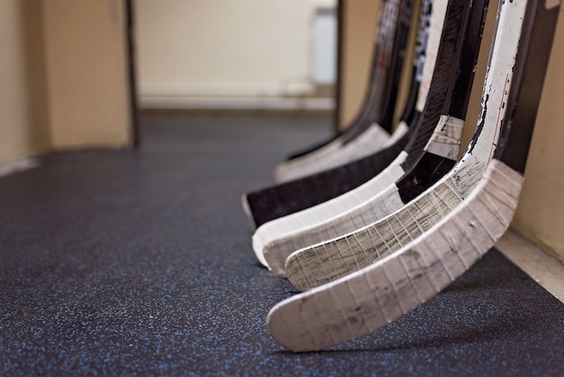 Hockey sticks near the locker room before the game