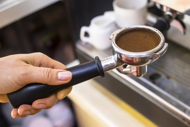 Holder from a coffee machine with ground coffee for espresso