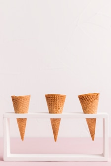 Holder with conical ice cream cornets