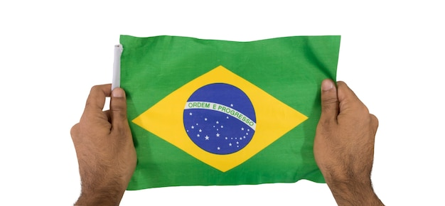 Holding a brazilian flag isolated on white background.
