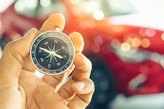 Holding compass on blurred background