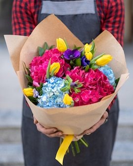Holding flower bouquet with blur background