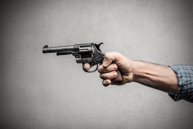 Holding a gun in a hand
