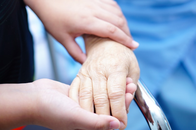 Holding hand asian senior or elderly old lady patient with love, care, encourage and empat
