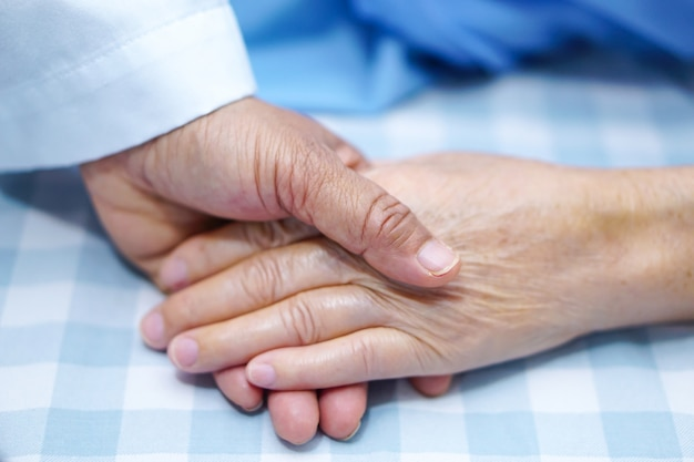 Holding hand asian senior or elderly old lady patient with love, care, encourage