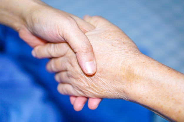 Holding hand asian senior or elderly old lady patient with love