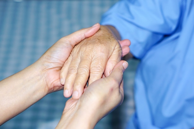 Holding hand asian senior or elderly old lady patient