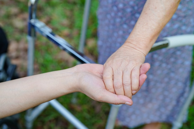 Holding hands asian senior or elderly old lady woman patient with love
