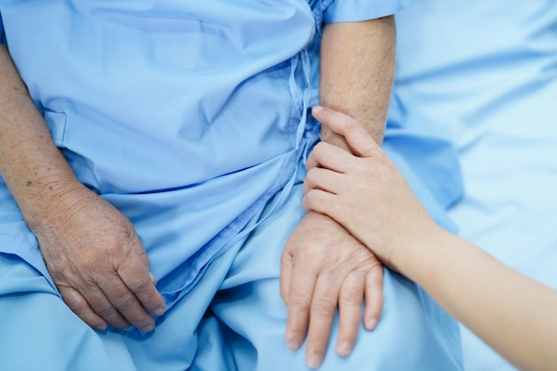 Holding hands with patient