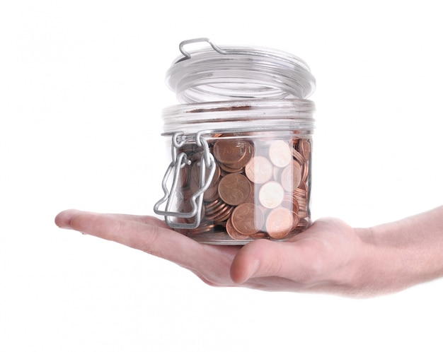 Holding a jar full of coins