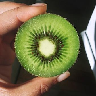 Holding a kiwi