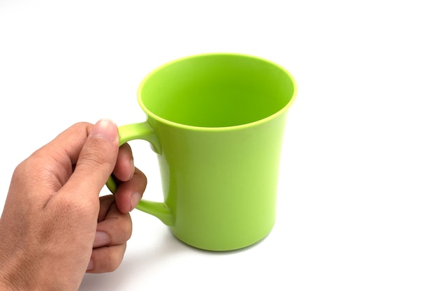 Holding plastic cup isolated on a white background