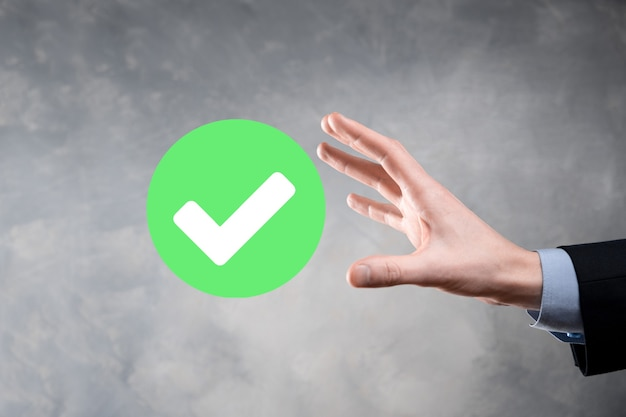 Holds green icon check mark,check mark sign, tick icon,right sign,circle green checkmark button,done
