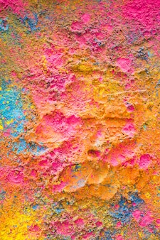 Holi colors randomly scattered on surface