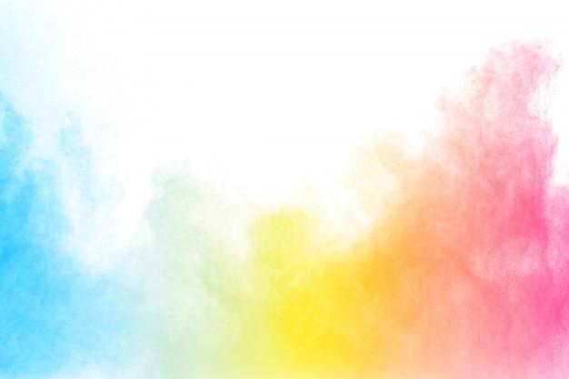 白い背景に抽象的なマルチカラーパウダー爆発。フェスティバルで塗られたholi。