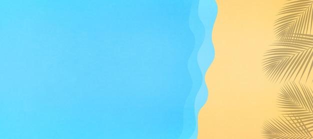 海のビーチのトップビューのペーパーカットと休日と夏の概念